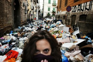 A woman walks though of uncollected garbage in the historic Spanish district of Naples on November 22, 2010. As piles of malodorous garbage continued to accumulate in the streets of Naples, the total amount of uncollected waste in the city was likely to reach 3,600 tons by the end of the day, the Italian press said. AFP PHOTO / ROBERTO SALOMONE (Photo credit should read ROBERTO SALOMONE/AFP/Getty Images)